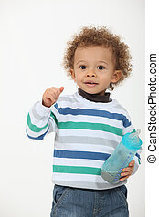 Toddler with milk bottle