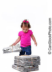 Toddler with recyclable paper - Toddler holding a stack of...