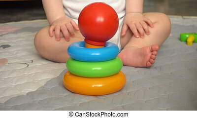 Toddler with the pyramid toy
