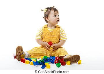 toddler, zetten, en, spel met, gebouw stel