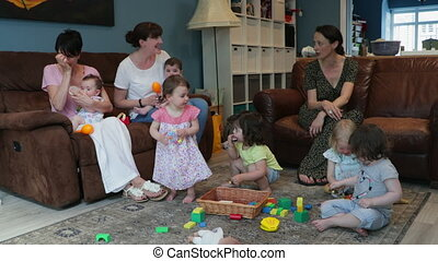 Toddlers Home Play Date - Mid-adults Talking While Their...