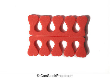 Toe separator isolated on a white background. Pair of toe separator in the form of small hearts. Spongy material.