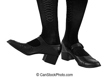 Tapping her toes. Black leather dress shoes and fancy stockings iosolated on a white background.
