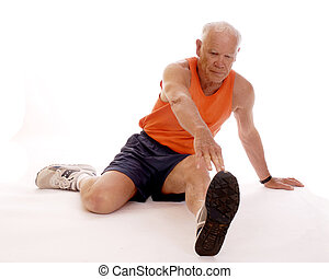 Toe-Touch Stretching - Senior man stretching out on the...