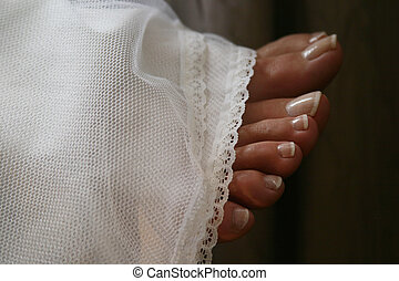 Toes - toes sticking out from wedding gown