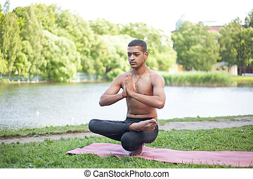 preparation for toestand yoga pose sporty handsome indian