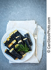 Tofu fried with nori on a plate