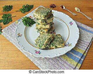 Tofu in green goutweed tempura on plate, cooking organic...
