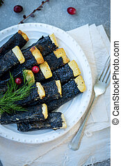 Tofu, nori fried with cranberries on a plate
