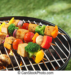 Tofu skewers grilling on a barbecue