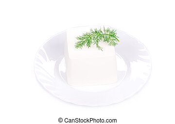 Tofu with dill on a plate.
