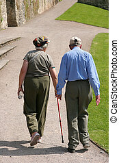 Together in Old Age - Elderly man and woman walking together...