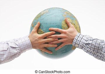 Together - Two hands holding a globe - zwei Hände halten ...