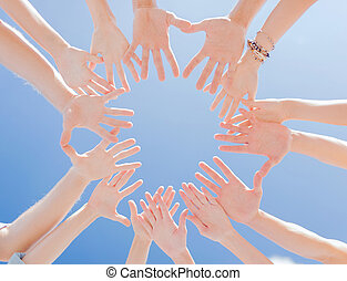 many hands over blue sky background