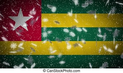 Togo flag falling snow loopable, New Year and Christmas background, loop.
