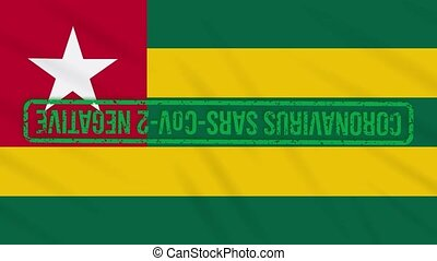 Togolese Republic swaying flag with green grunge stamp of freedom from coronavirus, loop