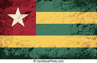 Togolese flag. Grunge background.