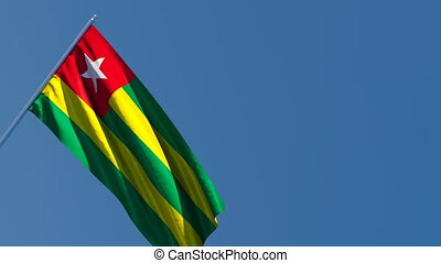 Togo's national flag flutters in the wind