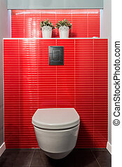 Toilet bowl, red tiles - White toilet bowl on wall of red...