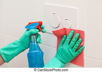 Toilet cistern cleaning - A man cleaning a toilet cistern...