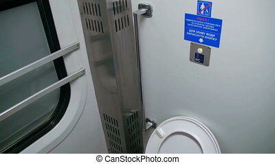 Toilet in a Train Carriage. Metal Toilet in a moving train....