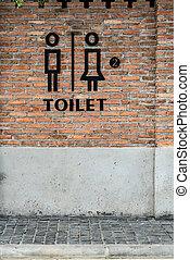 Toilet label on post