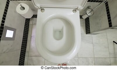 Toilet leaning out slow motion - Toilet closeup moving away,...