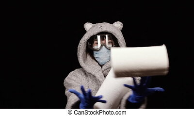 Toilet paper. A woman in a protective antivirus mask catches...