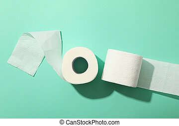Toilet paper on mint background, top view