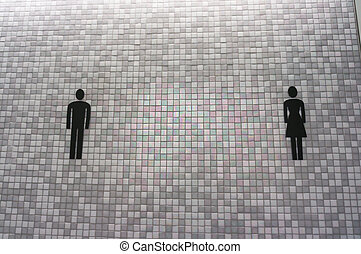 Toilet sign on mosaic wall