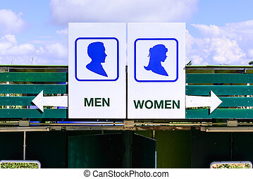 Toilet sign seperated men and women.