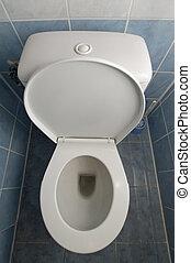 toilet - vertical photo of a white clean toilet, tiles on...
