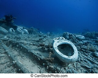 Toilet underwater in the sea