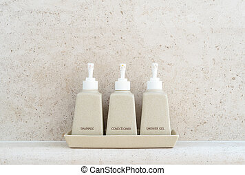 Toiletries tube in a luxury hotel, shower gel, shampoo and ...