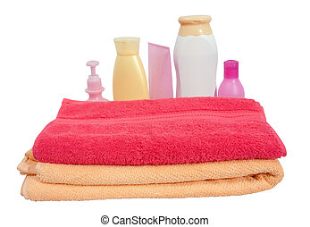 Toiletries with pink towel - Toiletries and soap on pink ...