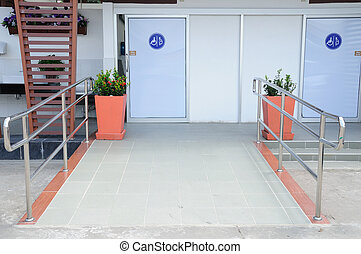 Toilets for disabled people and flowerpots