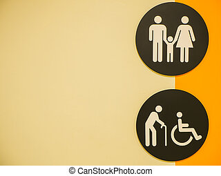 Toilets icon. Public restroom signs with a disabled access symbol on the wall in shopping mall.