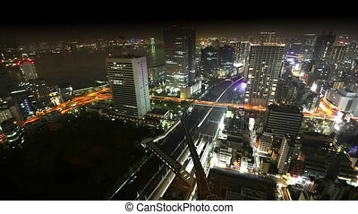 Tokyo Bay area skyline - Aerial view time lapse over Tokyo...