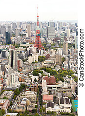 Tokyo, Japan  Apr 28, 2019 : Tokyo tower that locate around with many building, this tower is the famous landmark in Tokyo, Japan