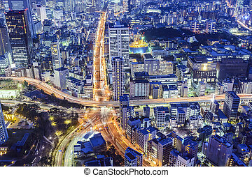 Tokyo, Japan cityscape over Roppongi Junction at night.