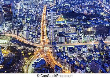 Tokyo, Japan cityscape over Roppongi Junction at night.