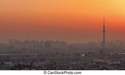 Tokyo, Japan, Timelapse - Shinjuku s Financial District of Tokyo and the Sky Tree Tower from Day to Night