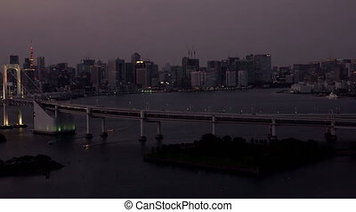 Tokyo skyline with Tokyo Tower and Rainbow Bridge after sunset in Odaiba, Tokyo, Japan, UHD 4K