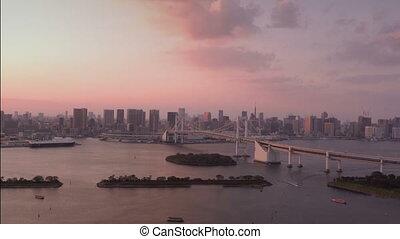 Tokyo skyline with Tokyo Tower and Rainbow Bridge at sunset in Odaiba, Tokyo, Japan, UHD 4K