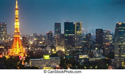 Aerial view of Tokyo Skyline at dusk with illuminated Tokyo Tower, icon and landmark of Minato Distric in Tokyo, Japan.