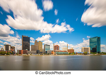Toledo, Ohio, USA downtown skyline on the Maumee River.