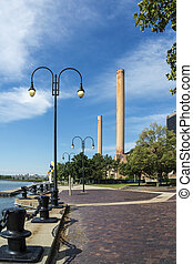 A view of downtown Toledo Ohio's river front on the Maumee river. A beautiful blue sky with white clouds for a backdrop.