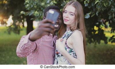 Tolerance theme. interracial couple take selfie. -...