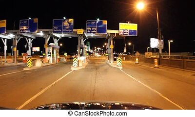 Toll Booth - Video driving through a toll booth, entering a...
