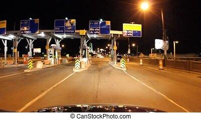 Video driving through a toll booth, entering a bridge. Dartmouth to Halifax